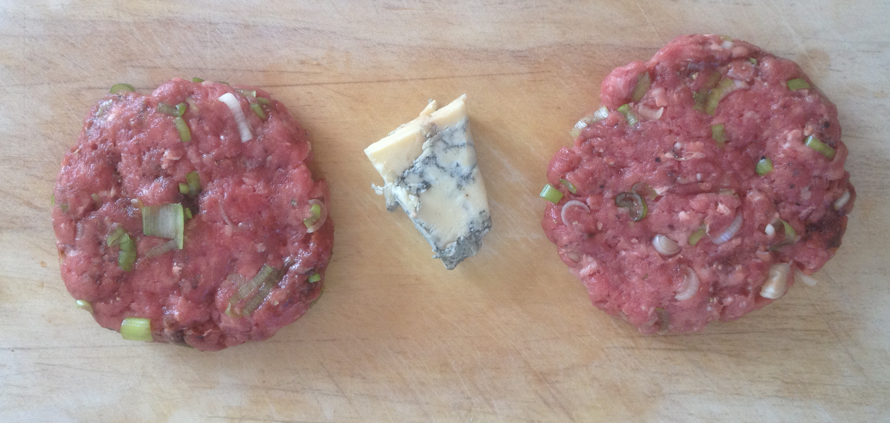 2. Make two thin burgers, place half the stilton between them and mould into one big fat burger.